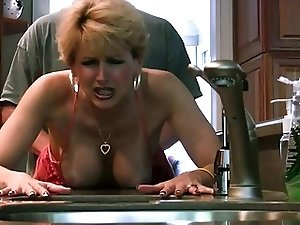 Busty Cougar gets hard cock in doggy style