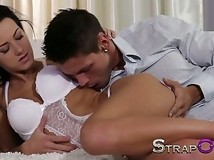 StrapOn Black haired babe fucks guy with big strapon cock